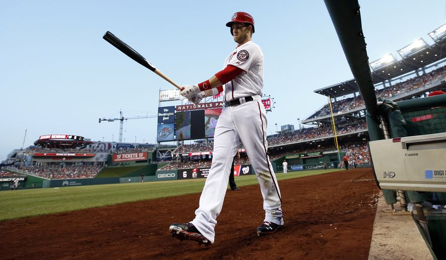 Washington Nationals left fielder Bryce Harper (34) steps on the field as he prepares to bat during an interleague baseball game against the Baltimore Orioles at Nationals Park, Monday, July 7, 2014, in Washington. (AP Photo/Alex Brandon)