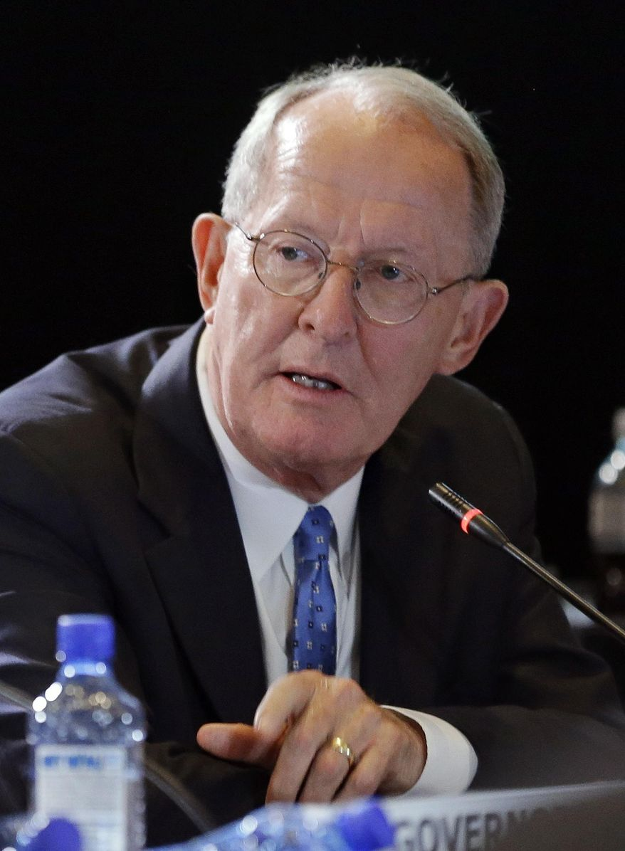 In this July 12, 2014 photo, Sen. Lamar Alexander, R-Tenn., takes part in a discussion at the National Governors Association convention in Nashville, Tenn. Early voting is getting underway for Tennessee's primary election that features tea party-styled challenges to Alexander's bid for the Republican nomination to a third term in the U.S. Senate. (AP Photo/Mark Humphrey)