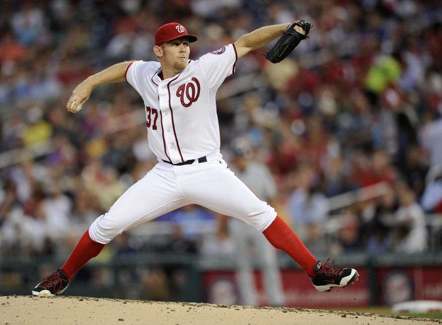 Washington Nationals starting pitcher Stephen Strasburg (37) delivers a pitch against the Milwaukee Brewers during the fourth inning of a baseball game, Friday, July 18, 2014, in Washington. (AP Photo/Nick Wass)