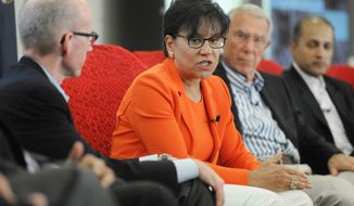 U.S. Secretary of Commerce Penny Pritzker, center, joins Michigan CEOs as they participate in a panel discussion on innovation Friday, July 18, 2014, during a Michigan Innovation Forum held at the Whirlpool Corp. North America Headquarters in Benton Harbor, Mich. Pictured right is Fred Bauer, Chairman and CEO of Gentex and Kevin Lobo, CEO and President of Stryker, far right. (AP Photo/The Herald-Palladium, Don Campbell) ** FILE **