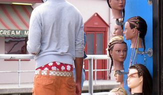 **FILE** A young man wears saggy pants on the Wildwood, N.J. boardwalk on June 6, 2013. (Associated Press)