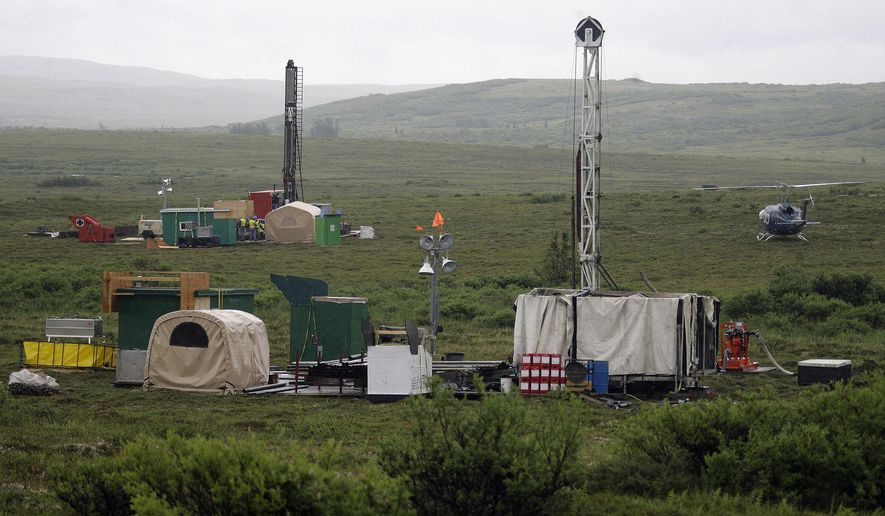 FILE - In this July 13, 2007 file photo, workers with the Pebble Mine project test drill in the Bristol Bay region of Alaska near the village of Iliamma. The U.S. Environmental Protection Agency is proposing restrictions that would essentially block development of a massive gold-and-copper prospect near the headwaters of a world-premier salmon fishery in Alaska. The Friday July 18, 2014 announcement comes as the EPA is being sued by the group behind the proposed Pebble Mine, the Pebble Limited Partnership, and the state of Alaska for exceeding its authority. (AP Photo/Al Grillo, File)