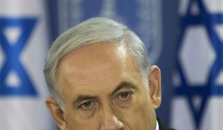Israeli Prime Minister Benjamin Netanyahu speaks during a cabinet meeting at the defense ministry in Tel Aviv, Israel, Friday, July 18, 2014. Israeli troops pushed deeper into Gaza on Friday to destroy rocket launching sites and tunnels, firing volleys of tank shells and clashing with Palestinian fighters in a high-stakes ground offensive meant to weaken the enclave's Hamas rulers.(AP Photo/Oded Balilty, Pool)
