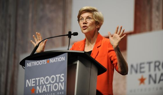 U.S. Sen. Elizabeth Warren, D-Mass., addresses the crowd during her appearance at the Netroots Nation conference in Detroit, Friday, July 18, 2014. Warren has captured the hearts of Democratic activists beginning to think about an heir to President Barack Obama. But their minds tell them that Hillary Rodham Clinton could help them hang onto the White House. (AP Photo/Detroit News, David Coates)
