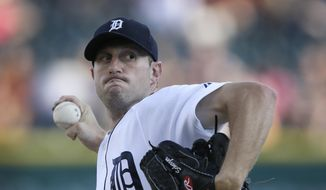 Detroit Tigers starting pitcher Max Scherzer throws during the first inning in the second baseball game of a doubleheader against the Cleveland Indians, Saturday, July 19, 2014 in Detroit. (AP Photo/Carlos Osorio)