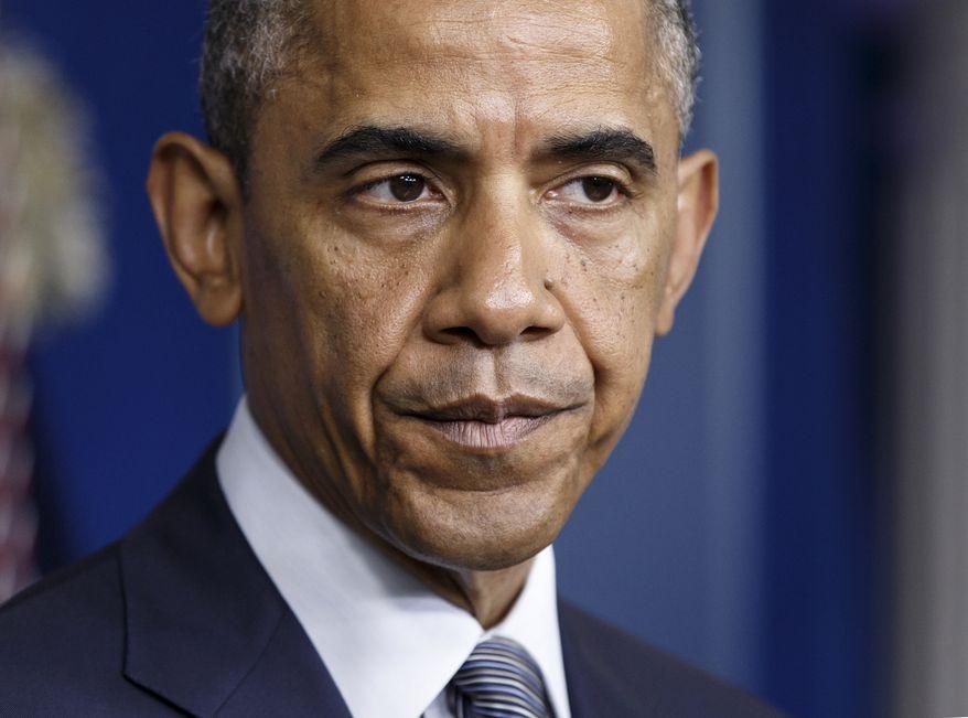 ** FILE ** President Obama speaks in the Brady Press Briefing Room of the White House in Washington, July 18, 2014 (AP Photo/J. Scott Applewhite)