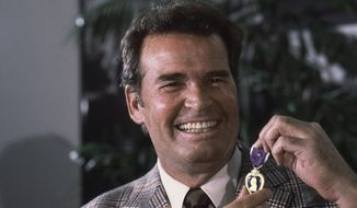 "FILE - Actor James Garner, left, smiles as he holds up the Purple Heart medal presented to him in a ceremony in this Monday, Jan. 24, 1983 file photo taken Los Angeles, Calif. Garner was wounded in April 1951 while with U.S. Forces in Korea, but his medal was never presented to him. Actor James Garner, wisecracking star of TV's ""Maverick"" who went on to a long career on both small and big screen, died Saturday July 19, 2014 according to Los angeles police. He was 86. (AP Photo/Lennox McLendon, File)"