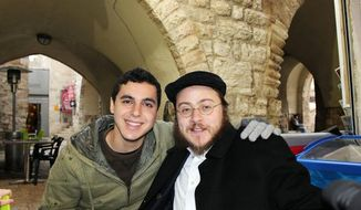 This 2012 photo provided by Rabbi Asher Hecht, shows Nissim Sean Carmeli, left, with Hecht in Jerusalem. The Israel Defense Forces said Sunday, July 20, 2014, in a statement that Carmeli was killed in combat in the Gaza Strip. Carmeli was from South Padre Island, Texas, said Deputy Consul General of Israel to the Southwest Maya Kadosh. (AP Photo/Rabbi Asher Hecht via Chabad of the Rio Grande Valley)