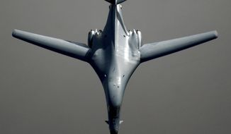 """FILE - In a March 25, 2003 file photo, a  B-1 bomber proceeds on its mission after receiving fuel from a KC-135 Stratotanker in the skies near Iraq in support of Operation Iraqi Freedom. Air Force officials are expected to decide by next month whether to go forward with a huge expansion of a bomber training area over the Northern Plains. The Air Force says expanding the Powder River Training complex to cover an area larger than West Virginia is needed to maintain readiness, and it's too expensive fly some bombers from the Dakotas to Utah and Nevada for combat exercises. Elected officials, pilots and others are resisting what a Montana official called a federal government """"airspace grab."""" (AP Photo/Staff Sgt. Cherie A. Thurlby, file)"""