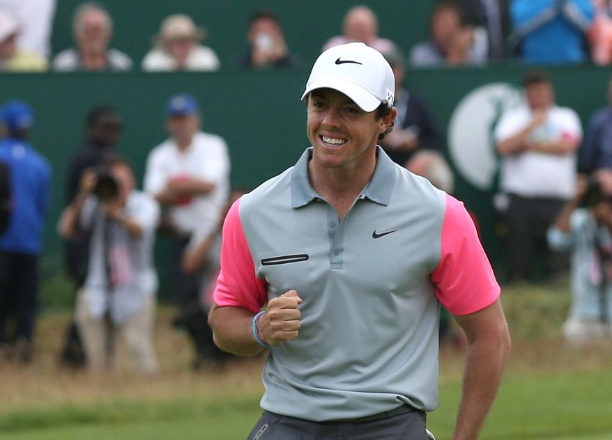 Rory McIlroy of Northern Ireland celebrates winning the British Open Golf championship  after the final round at the Royal Liverpool golf club, Hoylake, England, Sunday July 20, 2014. (AP Photo/Scott Heppell)