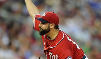 Washington Nationals starting pitcher Tanner Roark delivers a pitch against the Milwaukee Brewers during the third inning of a baseball game, Saturday, July 19, 2014, in Washington. (AP Photo/Nick Wass)