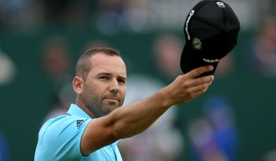 Sergio Garcia of Spain acknowledges the crowd as he walks up to the 18th green during the final round of the British Open Golf championship at the Royal Liverpool golf club, Hoylake, England, Sunday July 20, 2014. (AP Photo/Scott Heppell)