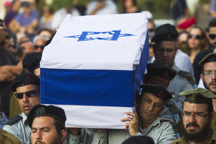 Israeli soldiers carry the coffin of Maj. Amotz Greenberg, 45, during his funeral in the Israeli city of Hod Hasharon, Sunday, July 20, 2014. According to reports, Greenberg was killed fighting a group of militants who infiltrated Israel through a tunnel from the Gaza Strip. (AP Photo/Dan Balilty)