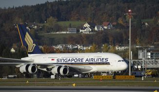 A Singapore Airlines Airbus A-380. (AP Photo/Keystone, Steffen Schmidt, File)