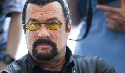 ** FILE ** This June 2, 2013, file photo shows actor Steven Seagal looking on as he waits for a news conference of the U.S. congressional delegation to Russia in the U.S. Embassy in Moscow,  Russia. (AP Photo/Alexander Zemlianichenko, File)