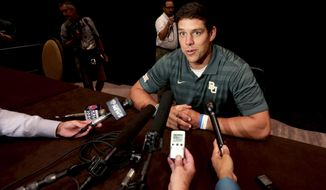 Baylor quarterback Bryce Perry speaks to reporters during the NCAA college Big 12 Conference Football media days in  Dallas, Monday, July 21, 2014. (AP Photo/LM Otero)