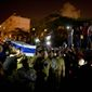Israeli soldiers carry the coffin of Sgt. Nissim Sean Carmeli during his funeral in Haifa, Israel. Sgt. Carmeli, of Texas, was killed in fighting on Sunday. (Associated Press)