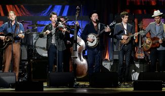 """From left, Chance McCoy, Ketch Secor, Morgan Jahnig, Critter Fuqua, Cory Younts and Gill Landry from Old Crow Medicine Show performing in Nashville, Tenn. The band had a big hit by adapting an unfinished Bob Dylan song into """"Wagon Wheel,"""" which became a staple in both Americana and country music."""