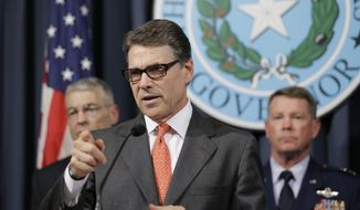 Gov. Rick Perry, center, speaks during a news conference in the Governor's press room, Monday, July 21, 2014, in Austin, Texas. Gov. Perry announced he is deploying up to 1,000 National Guard troops over the next month to the Texas-Mexico border to combat criminals that Republican state leaders say are exploiting a surge of children and families entering the U.S. illegally.  (AP Photo/Eric Gay)