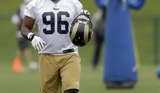 St. Louis Rams defensive end Michael Sam during an organized team activity at the NFL football team's practice facility Thursday, June 5, 2014, in St. Louis. (AP Photo/Jeff Roberson)
