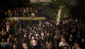 Thousands of Israelis attended the funeral of Sgt. Nissim Sean Carmeli, at the military cemetery in the northern Israeli city of Haifa. Sgt. Carmeli from Texas was killed in fighting in the Gaza Strip on Sunday.  (AP Photo/Oded Balilty)