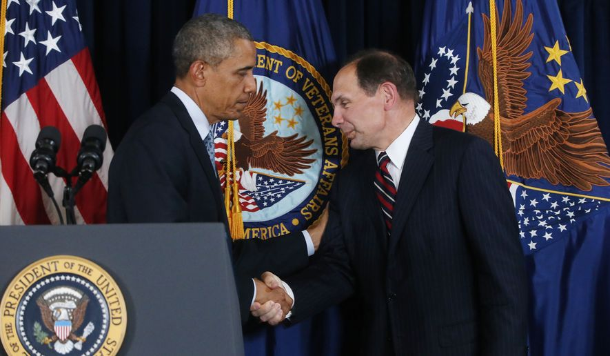 FILE - This June 2014 file photo shows President Barack Obama shaking hands with former Procter and Gamble executive Robert McDonald, his nominee as the next Veterans Affairs secretary, at the Department of Veterans Affairs in Washington.  A federal investigative agency says it is examining 67 claims of retaliation by supervisors at the VA against employees who filed whistleblower complaints. The independent Office of Special Counsel said 30 of the complaints about retaliation have passed the initial review stage and were being further investigated for corrective action and possible discipline against VA supervisors and other executives. The group's report comes as the Senate Veterans Affairs Committee holds a hearing Tuesday on the nomination of Robert McDonald to be VA secretary.  (AP Photo/Charles Dharapak)