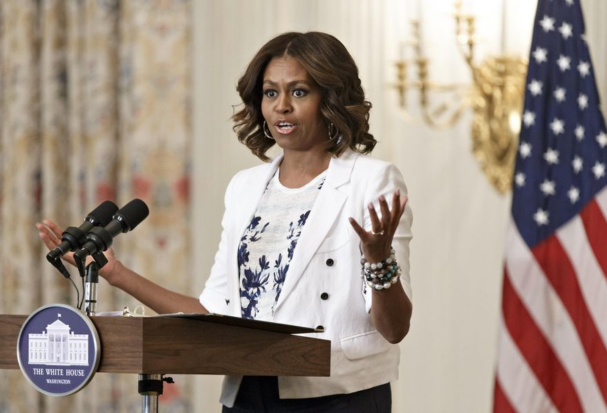 "First lady Michelle Obama, a longtime supporter of healthier eating and physical fitness, expands her push for America to drink more water, at a ""Drink Up"" event at the White House in Washington, Tuesday, July 22, 2014. Obama launched the campaign with the Partnership for a Healthier America to encourage people to drink plain water more often.  (AP Photo/J. Scott Applewhite)"