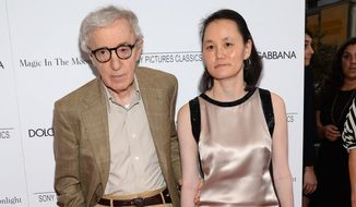 "Writer/director Woody Allen and Soon-Yi Previn arrive at the premiere of ""Magic In The Moonlight"" in New York on July 16, 2014. (Evan Agostini/Invision/Associated Press) **FILE**"