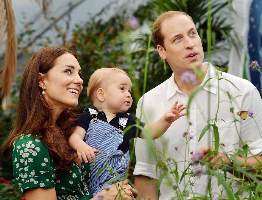 This photo taken Wednesday, July 2, 2014, and released Monday, July 21, 2014, to mark Prince George's first birthday, shows Britain's Prince William and Kate Duchess of Cambridge and the Prince during a visit to the Sensational Butterflies exhibition at the Natural History Museum, London. (AP Photo/John Stillwell, Pool)