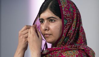 Activist Malala Yousafzai pauses, during the Girl Summit 2014  at the Walworth Academy, in London, Tuesday, July 22, 2014. Girls' rights campaigners including Malala Yousafzai are calling for an end to the practice of female genital mutilation.  (AP Photo, PA, Oli Scarff) UNITED KINGDOM OUT