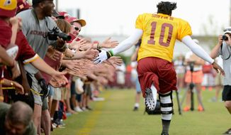 Demand from fans in Richmond to see Robert Griffin III and the Redskins at training camp is great enough that the team will hold a lottery for tickets to Fan Appreciation Day. (AndreW HARNIK/The Washington Times)