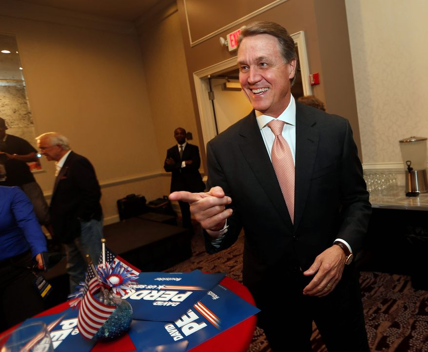 Businessman David Perdue at his own election-night watch party in Atlanta. The winner will face Democrat Michelle Nunn in November.