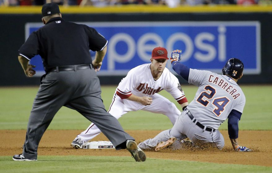 Detroit Tigers' Miguel Cabrera (24) is tagged out trying to advance to second after hitting an RBI single as Arizona Diamondbacks' Aaron Hill applies the tag during the sixth inning of a baseball game, Monday, July 21, 2014, in Phoenix.  (AP Photo/Matt York)