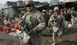 ** FILE ** U.S. soldiers patrol through Kabul, Afghanistan, in December, 2010. (Associated Press)