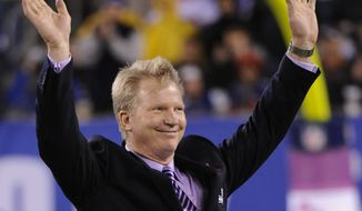 FILE - This Oct. 3, 2010, file photo shows former New York Giants player and current CBS analyst Phil Simms gesturing during the Ring of Honor Ceremony during an NFL football game between the Chicago Bears and the New York Giants at New Meadowlands Stadium, in East Rutherford, N.J.  (AP Photo/Bill Kostroun, File)