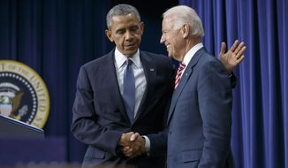 President Barack Obama embraces Vice President Joe Biden, right, before signing the Workforce Innovation and Opportunity Act, bipartisan job-training legislation which aims to help job seekers gain valuable employment skills, at the Eisenhower Executive Office Building in the White House complex in Washington, Tuesday, July 22, 2014. (AP Photo/J. Scott Applewhite) **FILE**