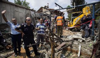 Israeli police officers secure a destroyed house that was hit by a rocket fired by Palestinians militants from Gaza, in Yahud, a Tel Aviv suburb near the airport, central Israel, Tuesday, July 22, 2014. As a result, Delta Air Lines and U.S. Airlines decided to cancel their scheduled flights to Israel.(AP Photo/Dan Balilty)