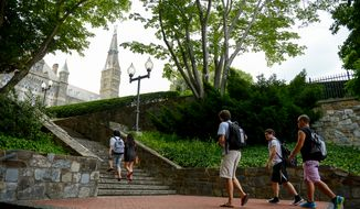 Summer students make their way along the Georgetown University campus, Washington, D.C., Tuesday, July 22, 2014. (Andrew Harnik/The Washington Times)
