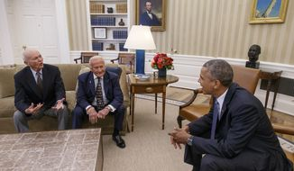 On the 45th anniversary of the Apollo 11 lunar landing, President Barack Obama meets with Apollo 11 astronauts Buzz Aldrin, center, and Michael Collins, left, in the Oval Office of the White House in Washington, Tuesday, July 22, 2014. Neil Armstrong, who took the first steps on the moon, died two years ago at the age of 82.  (AP Photo/J. Scott Applewhite)