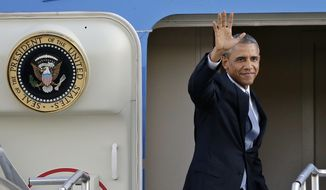 President Barack Obama waves as he prepares to depart Tuesday, July 22, 2014, from King County International Airport in Seattle. Obama is on a three-day West Coast trip that included at least five fundraising events in Seattle, San Francisco and Los Angeles. (AP Photo)