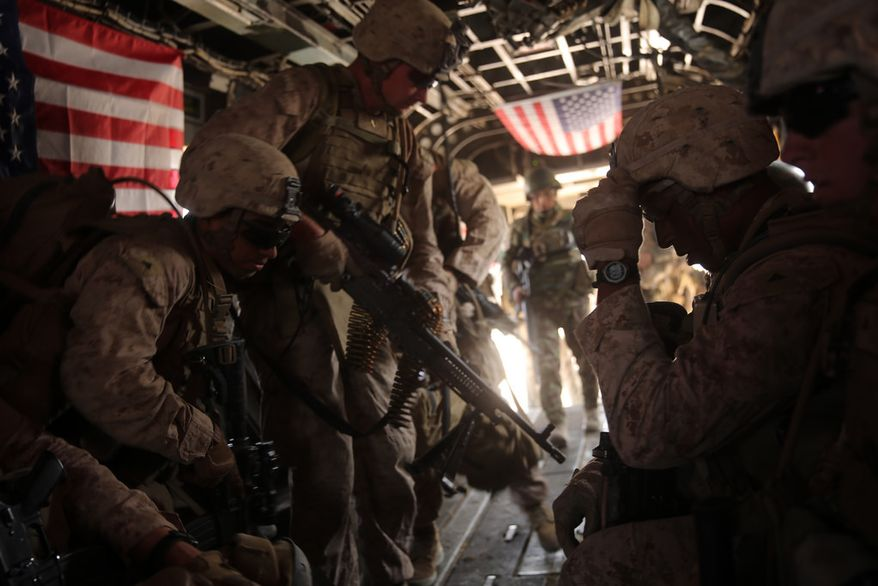 U.S. Marines with Bravo Company, 1st Battalion, 7th Marine Regiment board a CH-53E Super Stallion helicopter during a mission July 5, 2014, in Gereshk, Helmand province, Afghanistan.  U.S. Marine Corps photo.