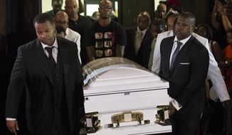 Pallbearers carry the casket of Eric Garner, the 43-year-old New York City man whose death while in police custody has led to accusations of police misconduct, at Bethel Baptist Church following his funeral service, Wednesday, July 23, 2014, in the Brooklyn borough of New York. An amateur video shows a plainclothes police officer placing Garner in what appears be a chokehold last Thursday on Staten Island.   (AP Photo/John Minchillo)