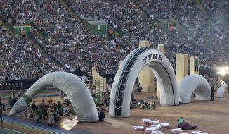 Performers dance with an effigy of the Loch Ness Monster during the opening ceremony for the Commonwealth Games 2014 in Glasgow, Scotland, Wednesday July 23, 2014. (AP Photo/Kirsty Wigglesworth)