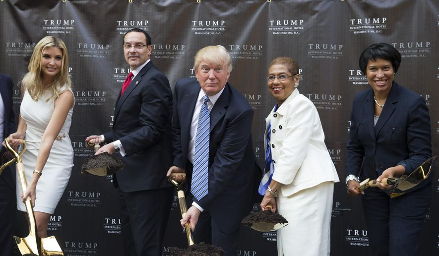 Donald Trump, center, poses for photographs during a ground breaking ceremony for the Trump International Hotel on the site of the Old Post Office, on Wednesday, July 23, 2014, in Washington. From left, Ivanka Trump, Washington Mayor Vincent Gray, Trump, Del. Eleanor Holmes Norton, D-D.C., and Muriel Bowser, the Democratic nominee for D.C. mayor. (AP Photo) ** FILE **