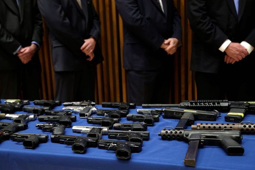 """""""Guns are the problem and access to guns are the problem,"""" said Robert Sanders, a former assistant director of the federal Bureau of Alcohol, Tobacco, Firearms and Explosives. He said a policy shift in the Justice Department under Attorney General Eric H. Holder Jr. has downgraded the pursuit of criminals with guns as a priority. (Associated Press photographs)"""
