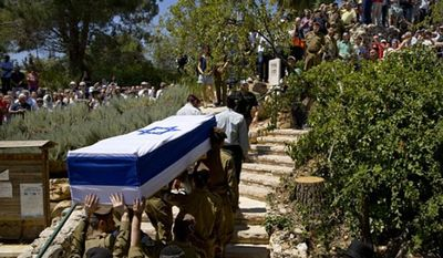 Israeli soldiers carry the coffin of Sgt. Max Steinberg during his funeral at the military cemetery in Jerusalem, Wednesday, July 23, 2014. (Associated Press)