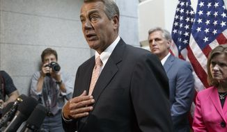 Speaker of the House John Boehner of Ohio, joined at right by incoming Majority Leader Rep. Kevin McCarthy of Calif., and Rep. Lynn Jenkins, R-Kan., talks with reporters on Capitol Hill in Washington, Wednesday, July 23, 2014, following a Republican strategy session. House Republicans want to slash President Barack Obama's emergency spending request for the border, speed young migrants back home to Central America, and send in the National Guard.  (AP Photo/J. Scott Applewhite)