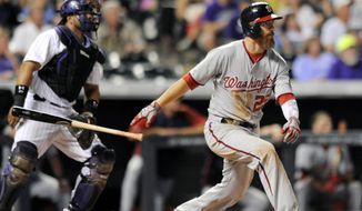 Washington Nationals first baseman Adam LaRoche hits a three-run home run in the seventh inning of a baseball game against the Colorado Rockies on Tuesday, July 22, 2014, in Denver. (AP Photo/Chris Schneider)