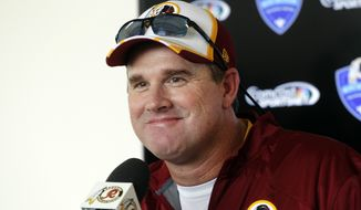 New Washington Redskins head coach Jay Gruden meets with reporters on the day prior to the opening of a NFL training camp in Richmond, Va, Wednesday, July 23, 2014. (AP Photo/Richmond Times-Dispatch, Joe Mahoney)