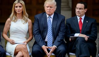 Donald J. Trump, center, his daughter Ivanka Trump, left, and Mayor Vincent Gray, right, sit on stage before they participate in a groundbreaking ceremony for the Trump International Hotel, a $200 million redevelopment of the iconic Old Post Office building on Pennsylvania Ave., Washington, D.C., Wednesday, July 23, 2014. (Andrew Harnik/The Washington Times)
